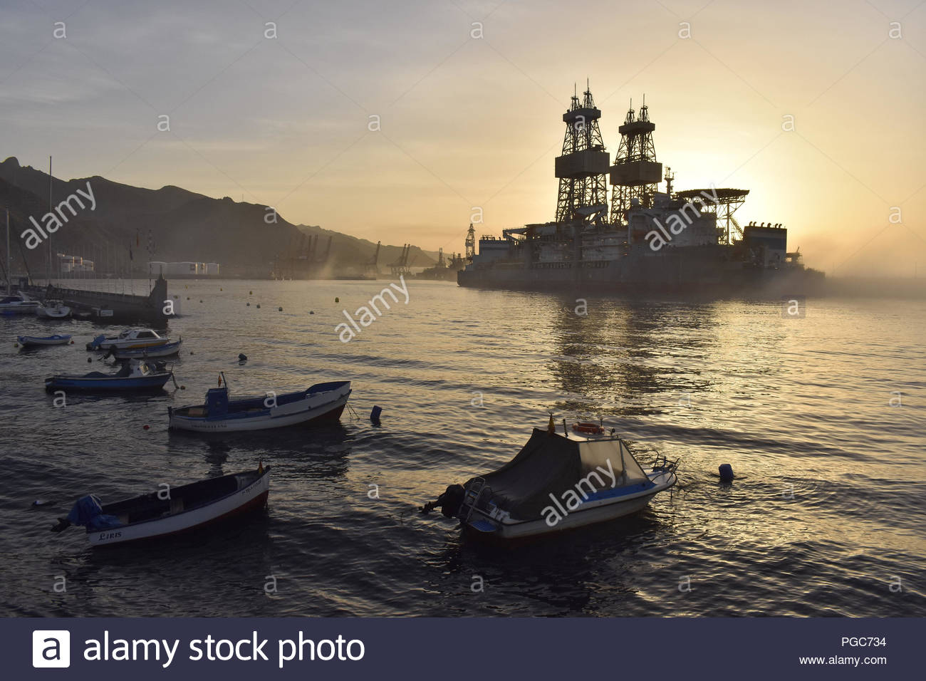 Drillship (oil rig platform) in morning fog. Santa Cruz de Tenerife harbor, Tenerife Canary Islands Spain. Stock Photo
