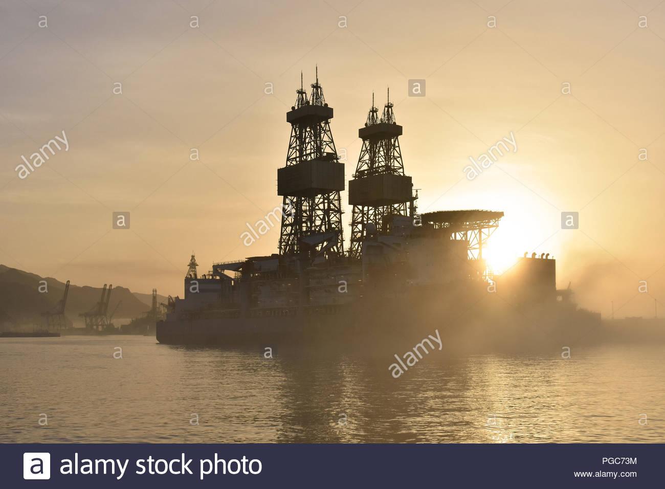Drillship (oil rig platform) in morning fog. Santa Cruz de Tenerife harbor, Tenerife Canary Islands Spain. - Stock Image