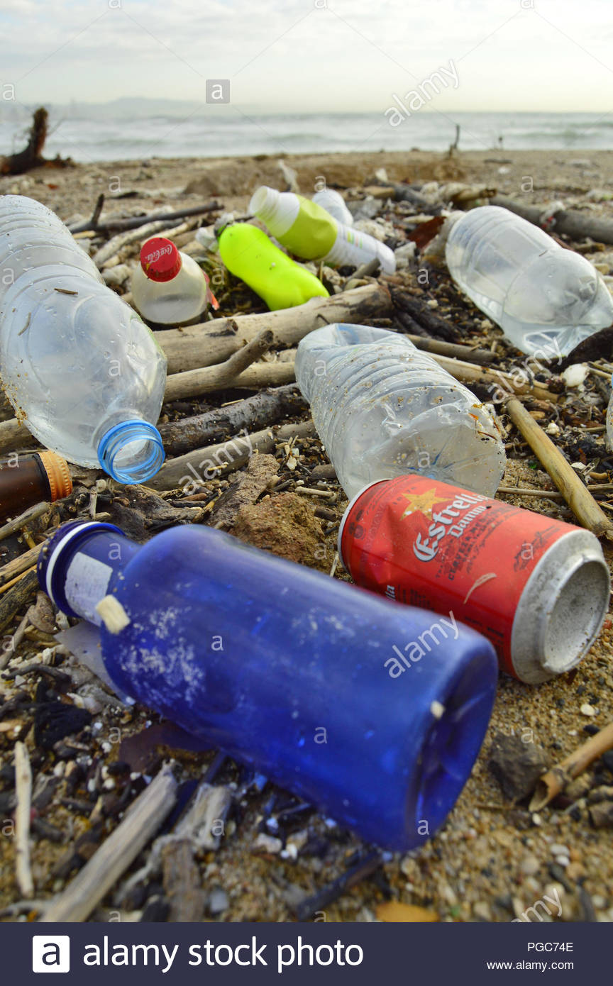 Marine debris plastic rubbish washed up on Barceloneta beach in Barcelona Spain Europe. - Stock Image