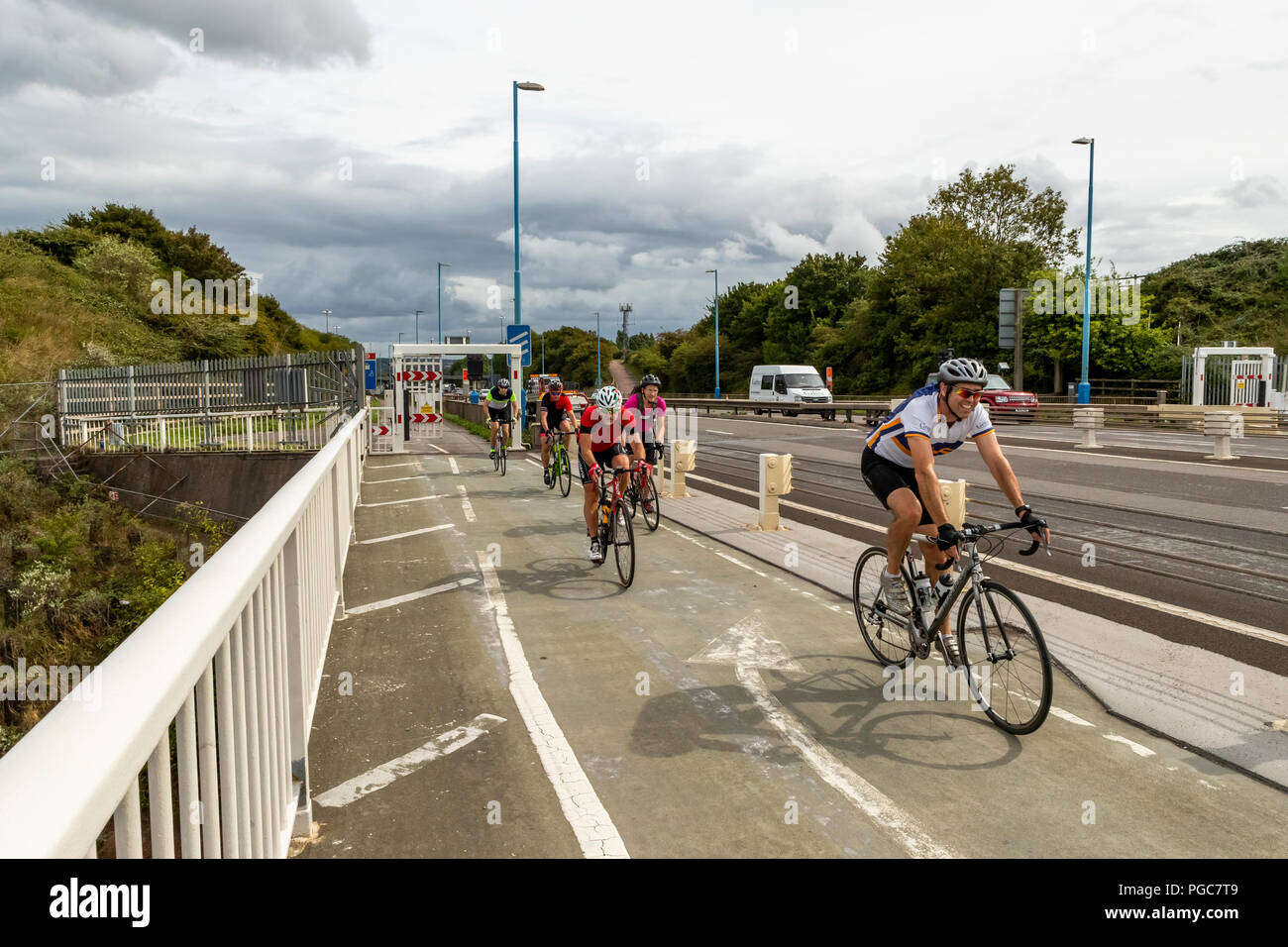 Cyclists using the other traffic lane to cross the M48 Severn Bridge from England into Wales. UK Stock Photo