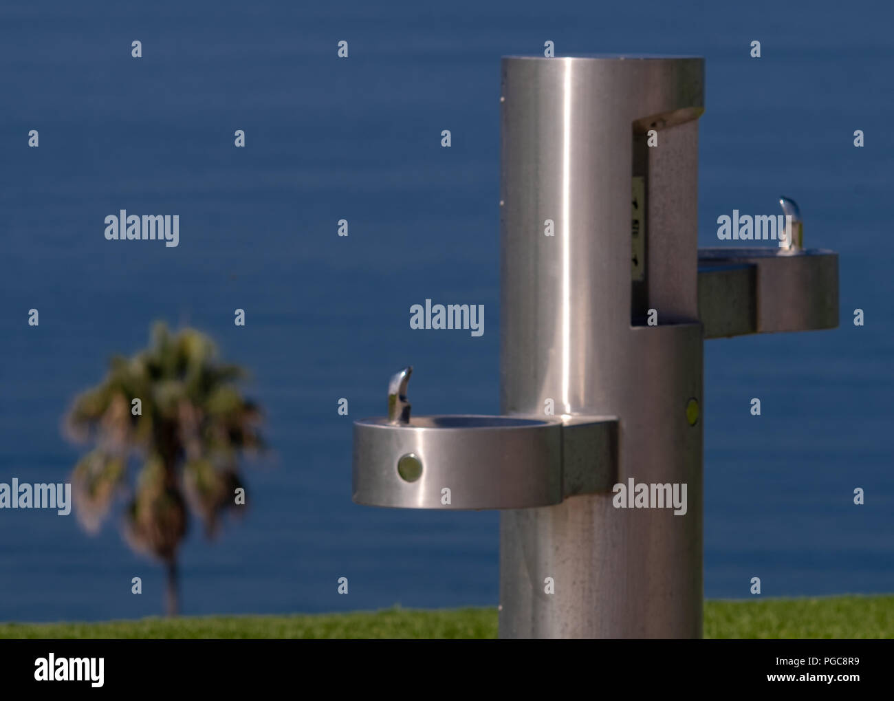 Water fountain in paradise, to go with your cheeseburger in paradise. - Stock Image