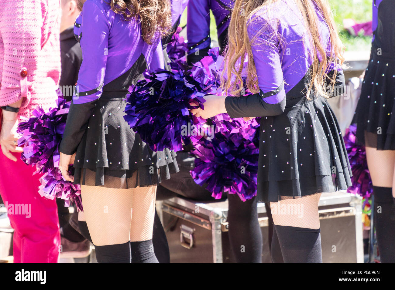 Cheerleaders in purple suits - Stock Image