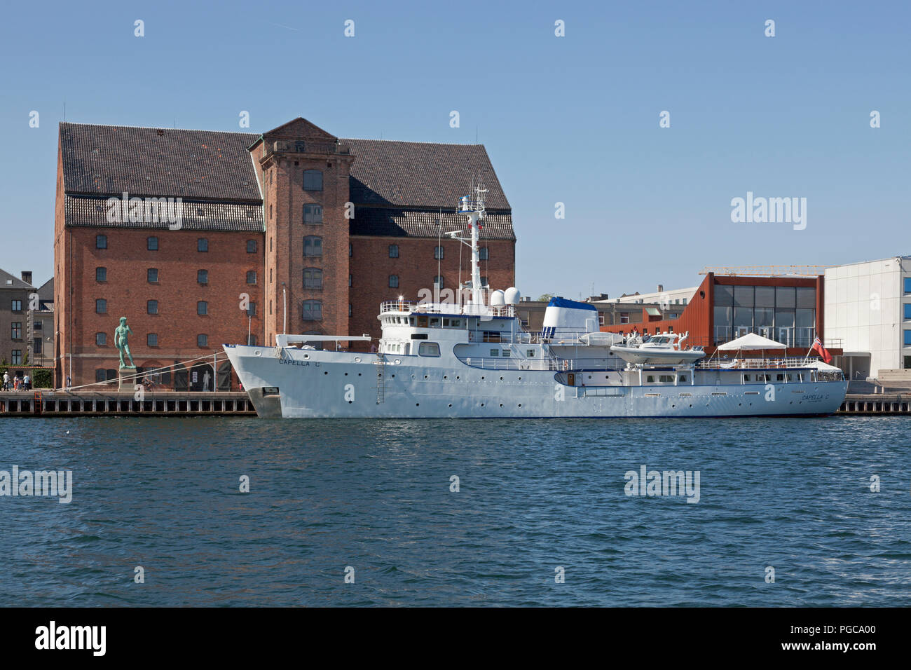 British yacht Capella C moored at Toldbodgade at sculpture David and art gallery Royal Cast Collection in the old West Indian warehouse in Copenhagen Stock Photo