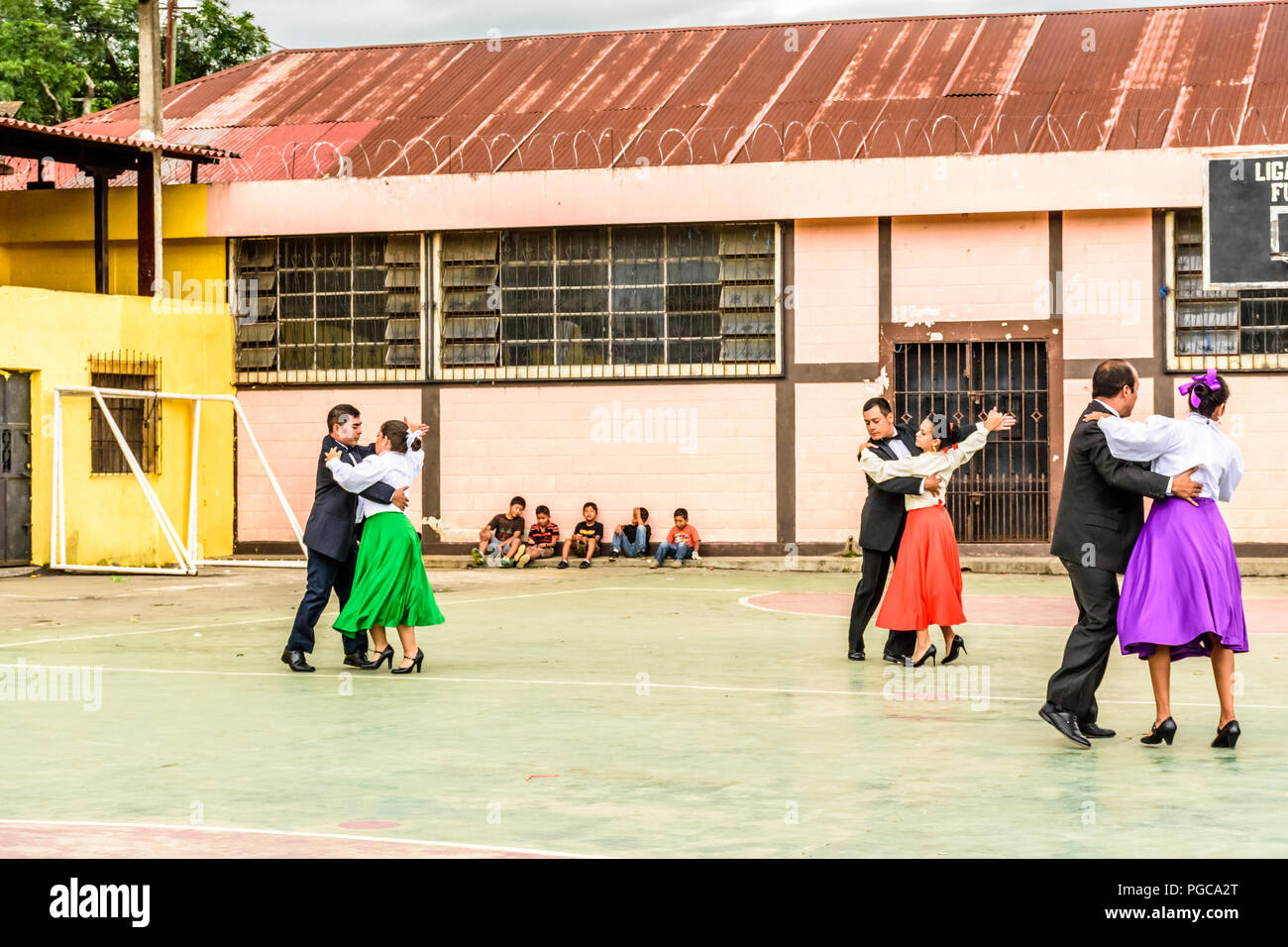 San Juan del Obispo, Guatemala -  August 3, 2018: Guatemalan folk dancers perform near UNESCO World Heritage Site of Antigua. - Stock Image