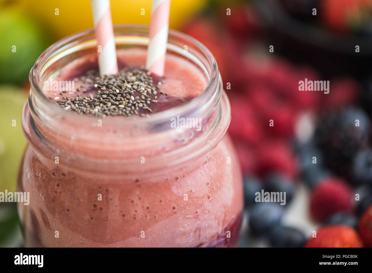 Detail of Fresh Smoothie with Fruit in Background - Stock Image
