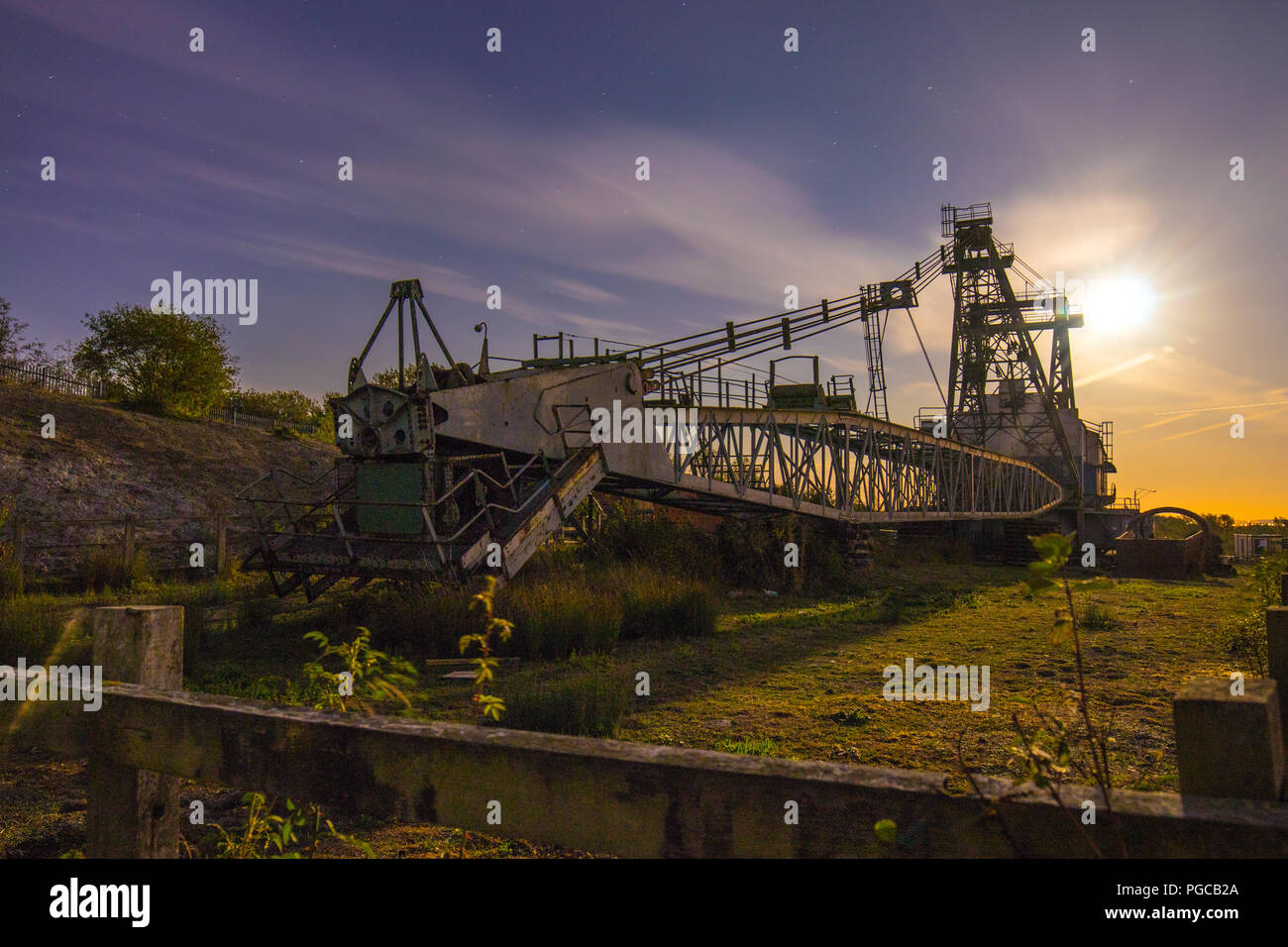 A Ruston Bucyrus Erie 1150 Walking Dragline at night at RSPB St Aidan's in West Yorkshire - Stock Image