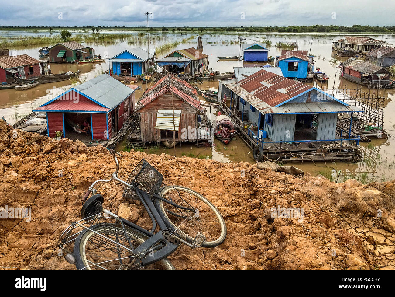 These are house boats in a large lake by Siem Reap, Cambodia. The group of boats are on Phnom Krom Lake and is a village called Chong Kneas. - Stock Image