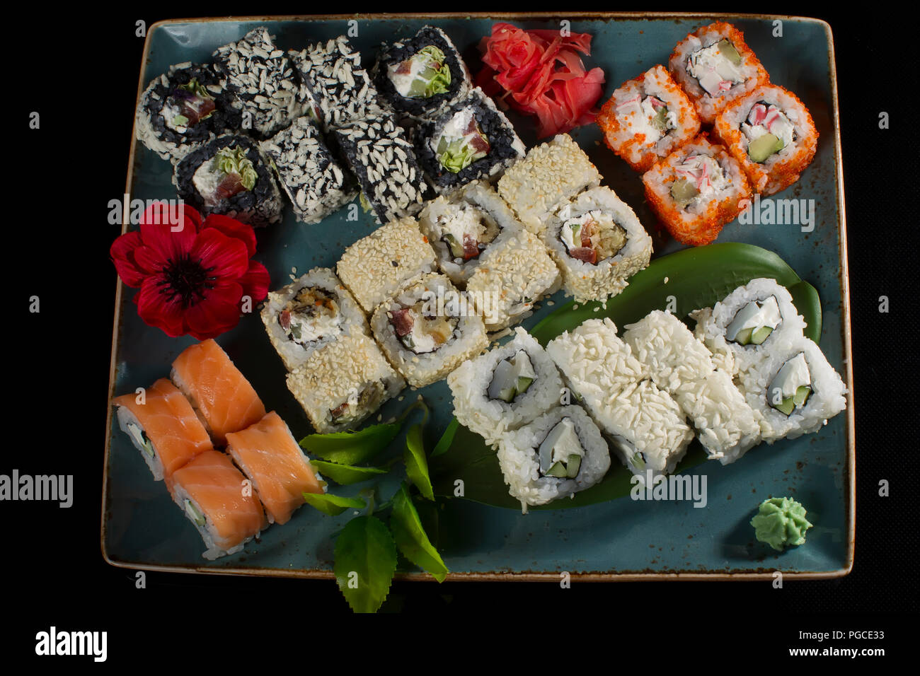Menu of the Japanese restaurant. Several sushi laid out on a plate with ginger sauce wasabi. Rolls from above Stock Photo