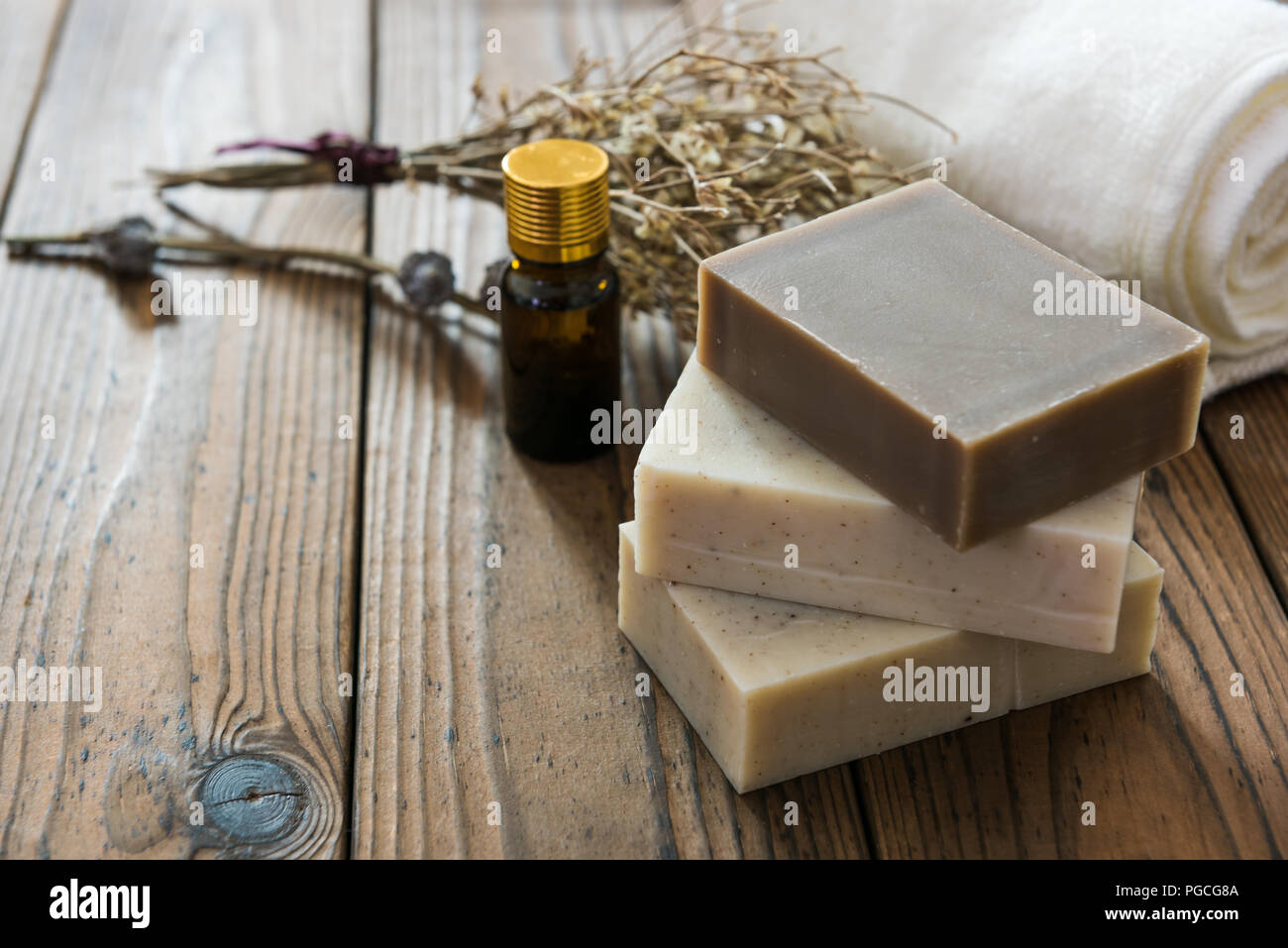 Handmade natural soap on wooden background - Stock Image