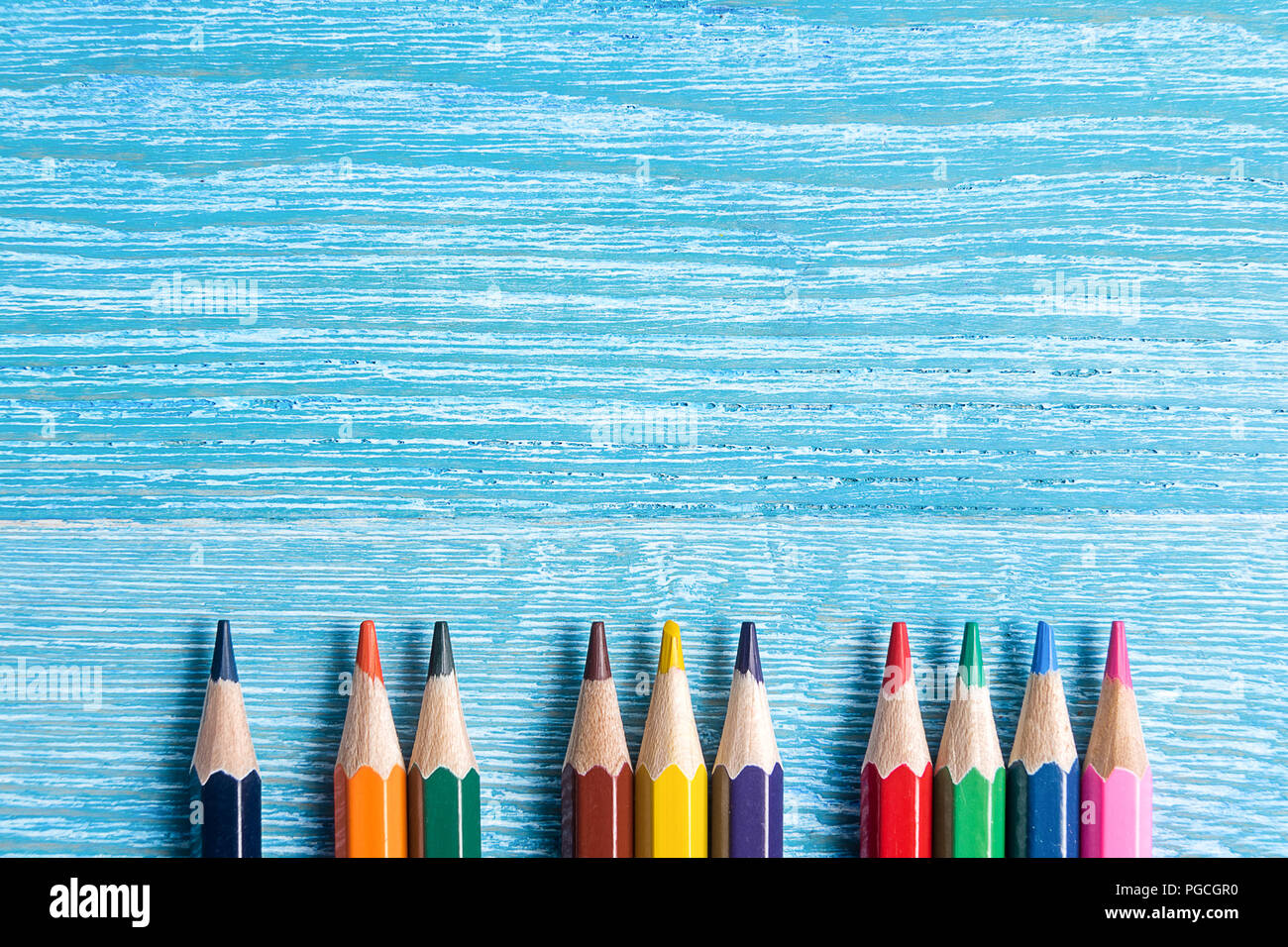 Back to school concept - pencils, rulers and wooden background - Stock Image