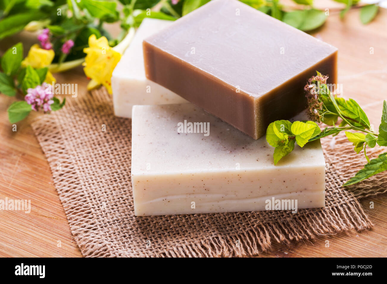 Beautiful spa setting with handmade soap - Stock Image
