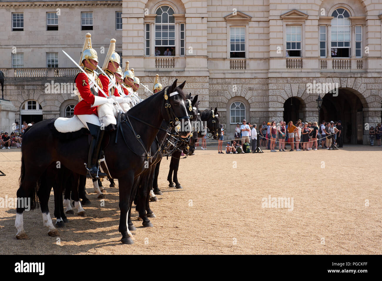 London / UK - July 26th 2018: Soldiers, mounted on horseback, on guard at Horseguard's Parade in London - Stock Image