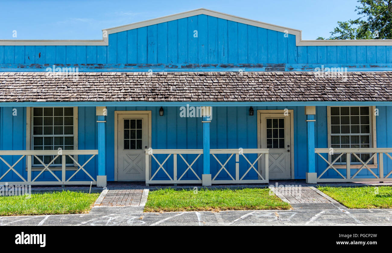 Front of old west style wooden building, painted blue, wood planks - Davie, Florida, USA - Stock Image