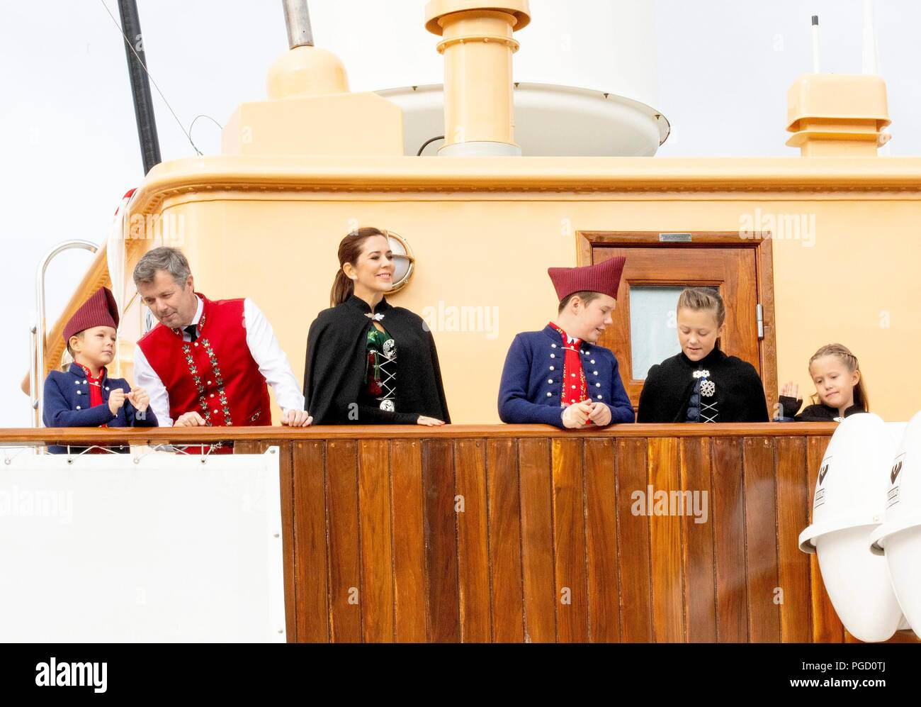 Crown Prince Frederik, Crown Princess Mary, Prince Christian, Princess Isabella, Prince Vincent and Princess Josehpine of Denmark arrive with the The Royal Ship, HDMY Dannebrog at Bakkafrost in Glyvrar, on August 25, 2018, on the 3rd of the 4 days visit to the Faroe Islands  Photo : Albert Nieboer /  Netherlands OUT / Point de Vue OUT | - Stock Image