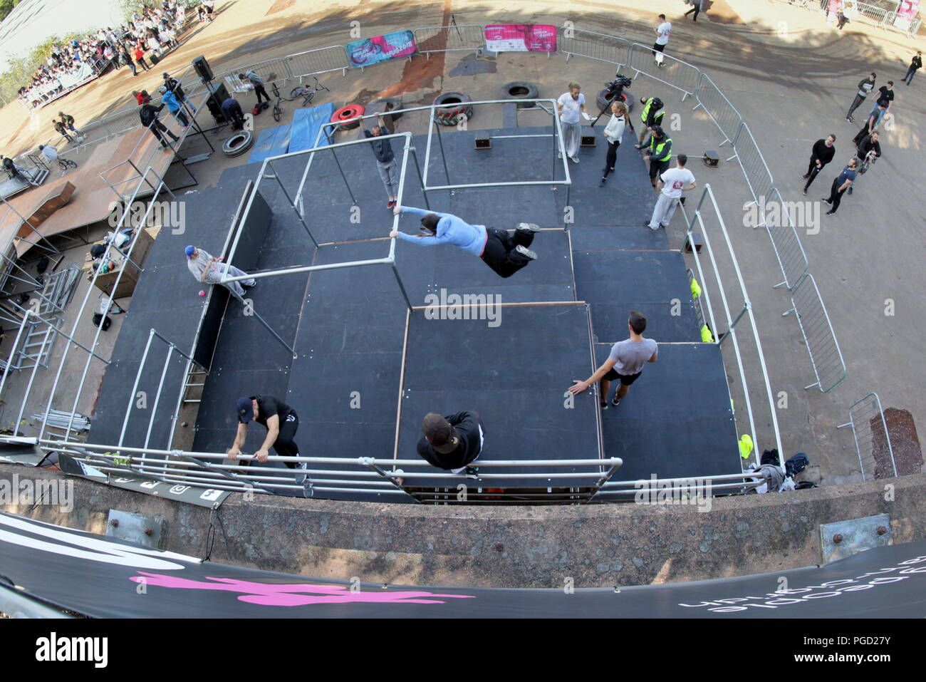 Glasgow, Scotland, UK. 25th  August, 2018. UK Weather: Brighter weather sees locals come out for the Youth Urban Games at Rotterdam Wharf speirs wharf on the forth and Clyde canal for Parkour, bmx biking  and skateboarding. Gerard Ferry/Alamy news Credit: gerard ferry/Alamy Live News Stock Photo