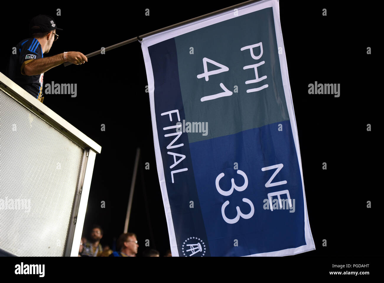 Chester, Pennsylvania, USA. 25th Aug, 2018. A Philadelphia Union fan reminds the New England Revolution players and fans of the final score of the superbowl between New England and the Philadelphia Eagles at Talen Energy Filed in Chester PA Credit: Ricky Fitchett/ZUMA Wire/Alamy Live News - Stock Image