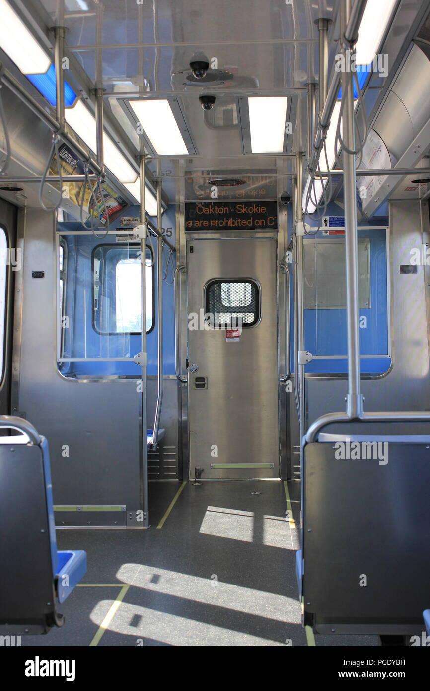 CTA Yellow Line Skokie Swift commuter train interior of the 5000 series. - Stock Image