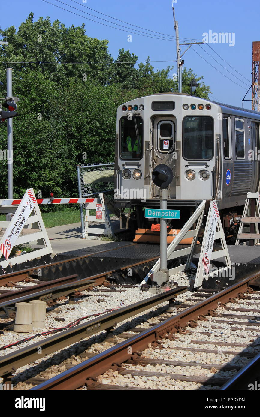 CTA Yellow Line Skokie Swift commuter train rolling into the Dempster Street Station. - Stock Image