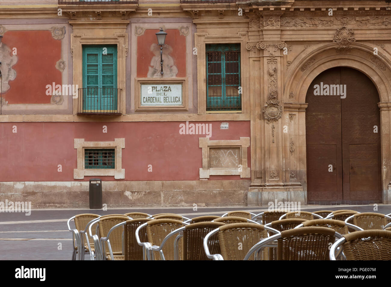August 2017 - cafe chairs on Plaza del Cardenal Belluga, historic square in the center of Murcia, Spain - Stock Image