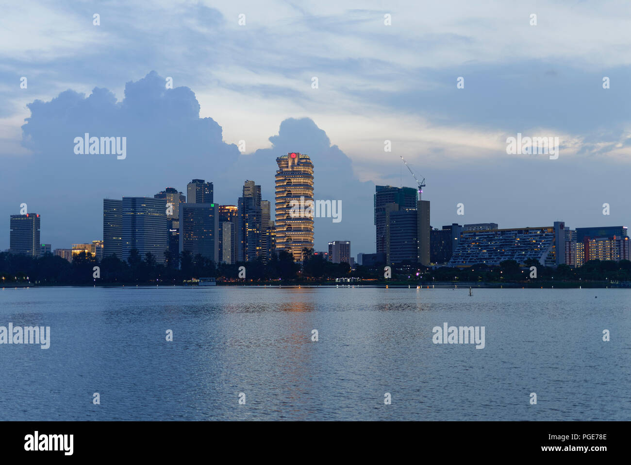 Singapore  - June 23, 2018: Sunset over Singapore River with city in the back - Stock Image