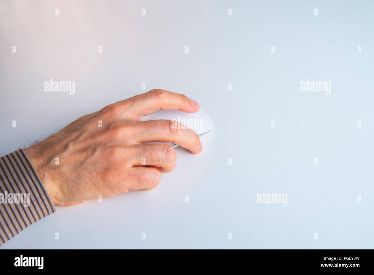 Man's hand using computer mouse. - Stock Image