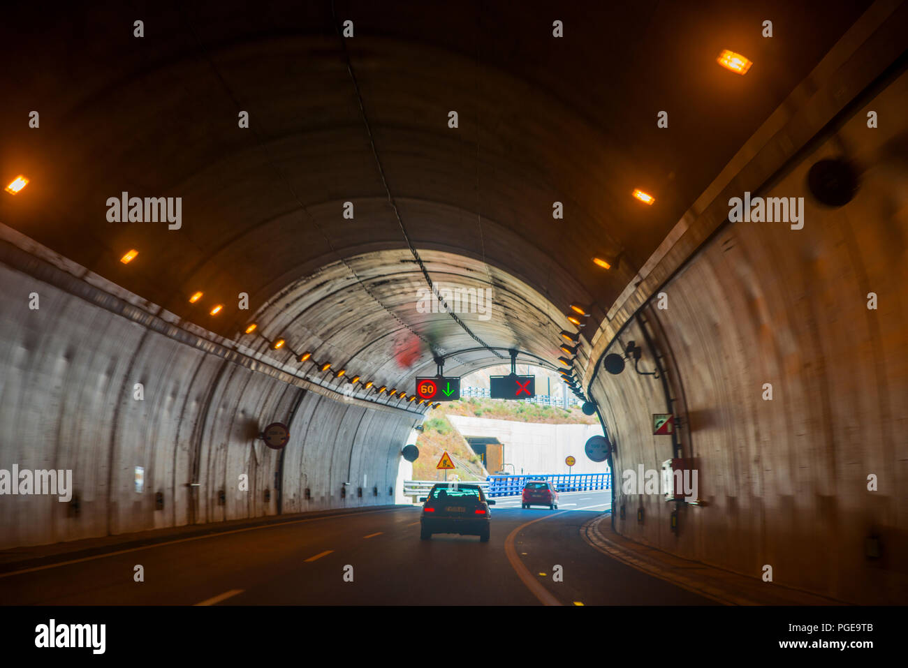 Traffic inside a tunnel. - Stock Image