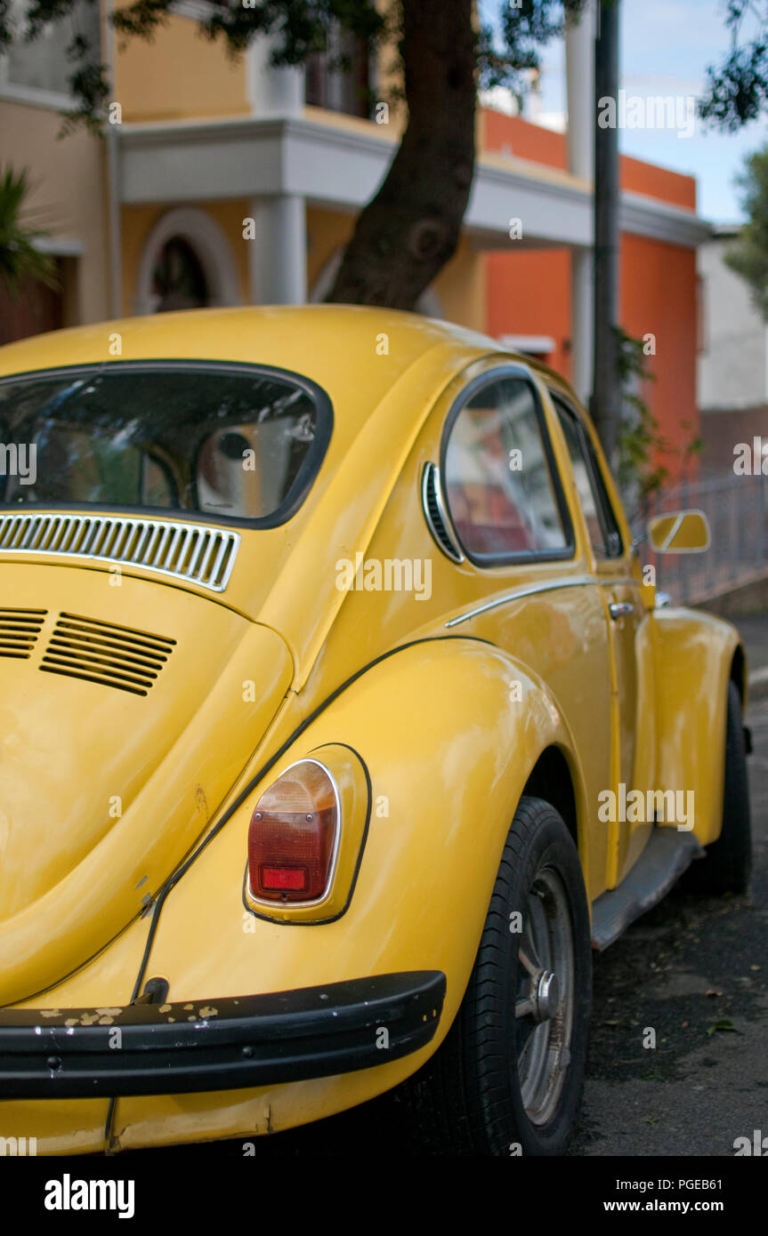 Yellow classic VW Beetle parked - Stock Image