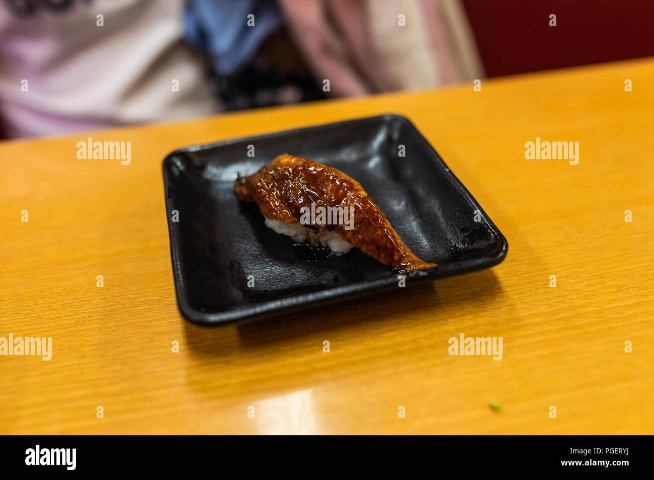 Eel on plate sitting on table. - Stock Image
