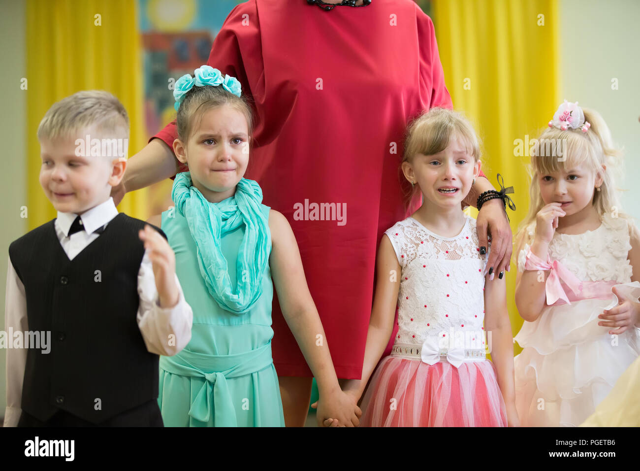 Belarus, Gomel, May 24 2018. The kindergarten is central. Open Day.Girls graduating from kindergarten crying on the matinee - Stock Image