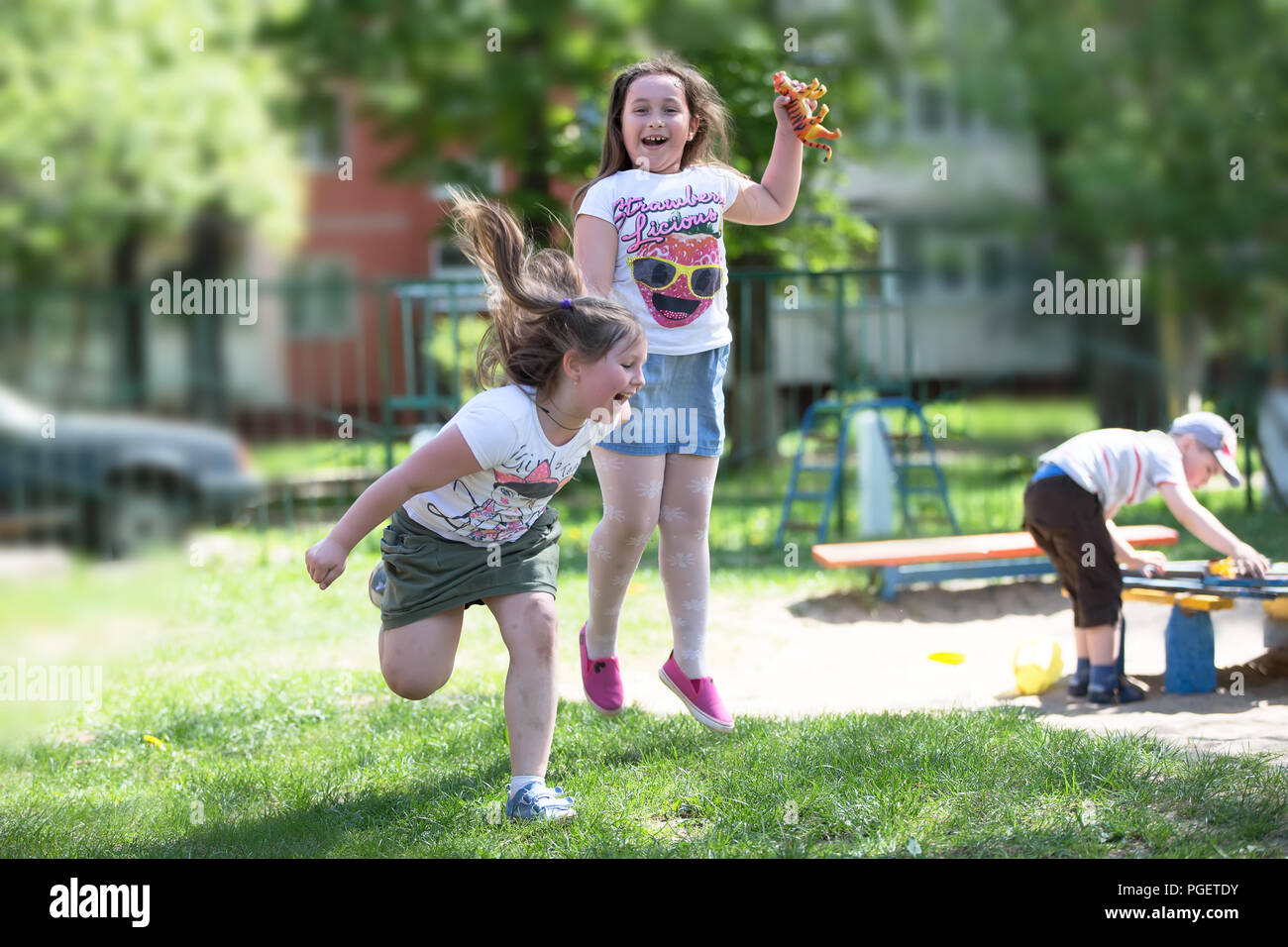 Belarus, Gomel, May 29, 2018. The kindergarten is central. Open Day.Two fat pre-school girls are playing on the street. Happy girls of six seven years - Stock Image
