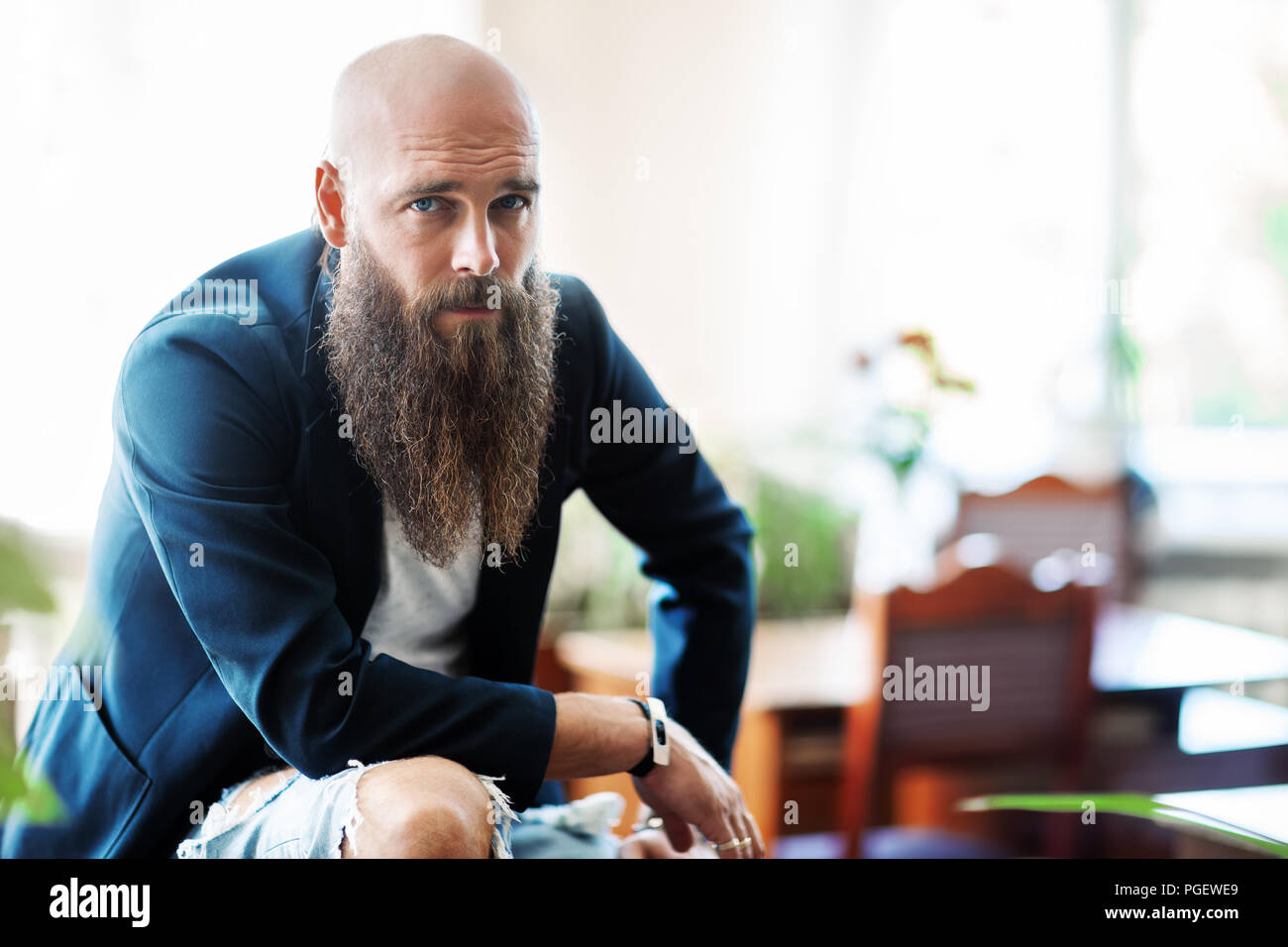 Portrait of bearded handsome confident man. Hipster lifestyle Stock Photo