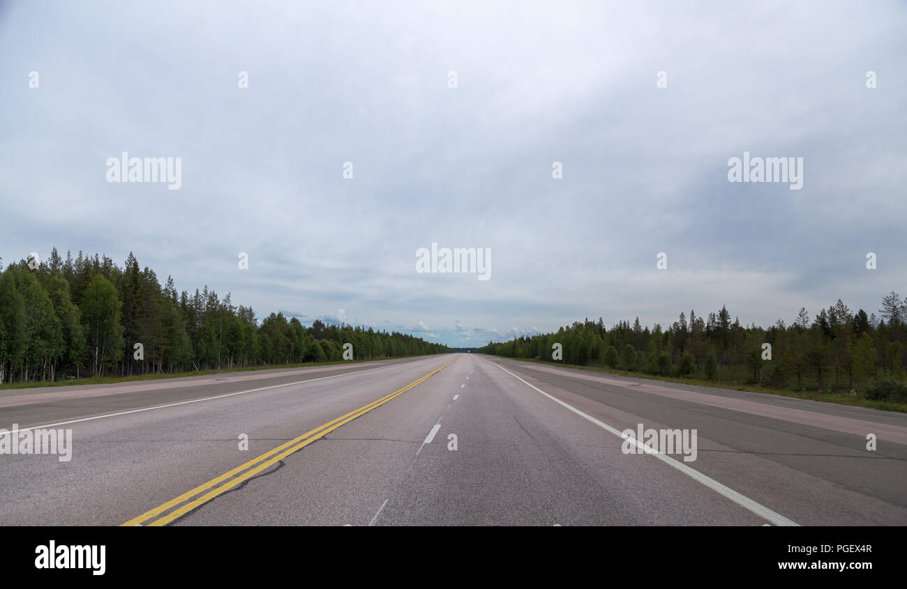Lapland Finland, wide road that is a emergency landing place for airplanes on a summer day - Stock Image