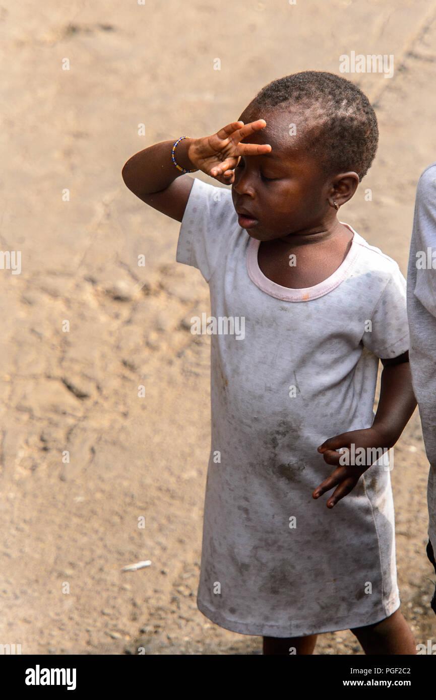08e84b0fd ACCRA, GHANA - JAN 8, 2017: Unidentified Ghanaian little girl in dirty white
