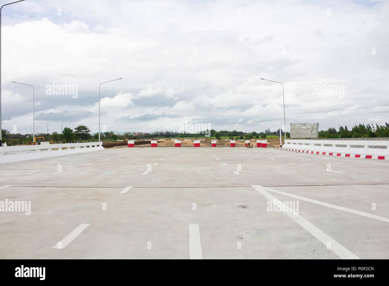 Worn Road Closed barricade blocks road construction site - Stock Image