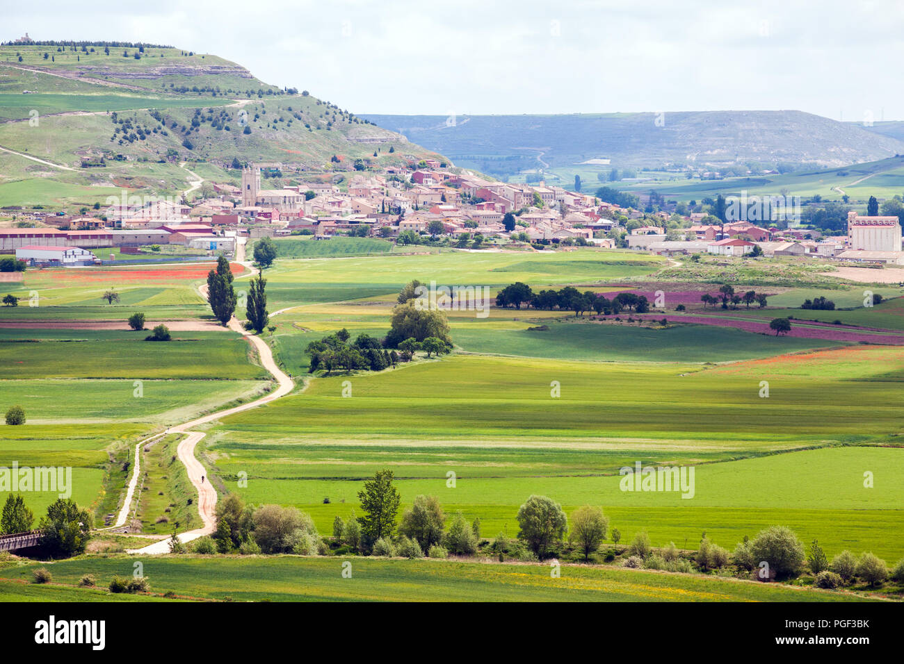 View back towards the town of Castrojeriz and the Camino de Santiago the way of St James pilgrim route Castille y Leon - Stock Image