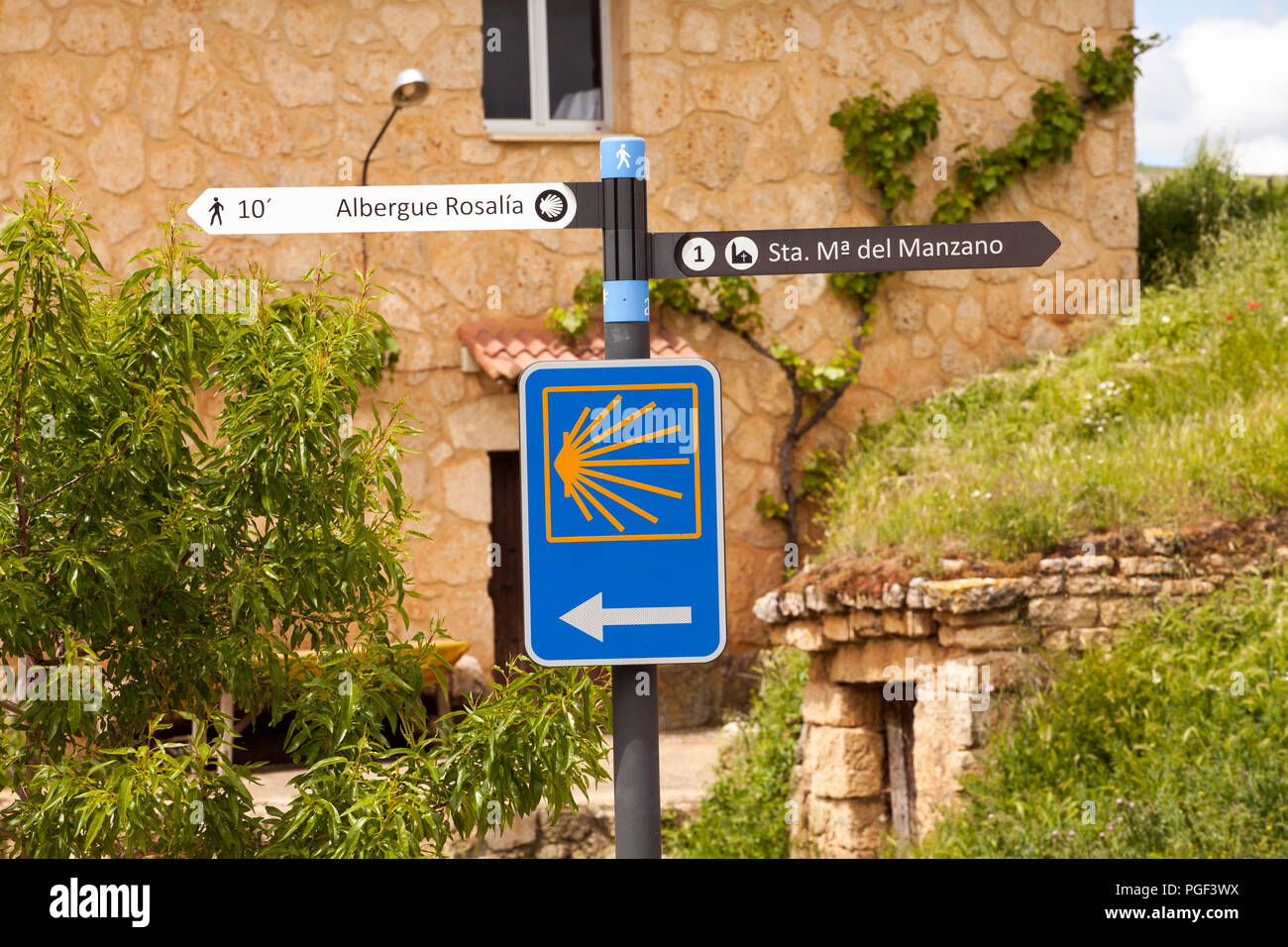 Way marker direction signpost on the Camino de Santiago the way of St James pilgrimage route in the town of Castrojeriz Burgos Spain Stock Photo