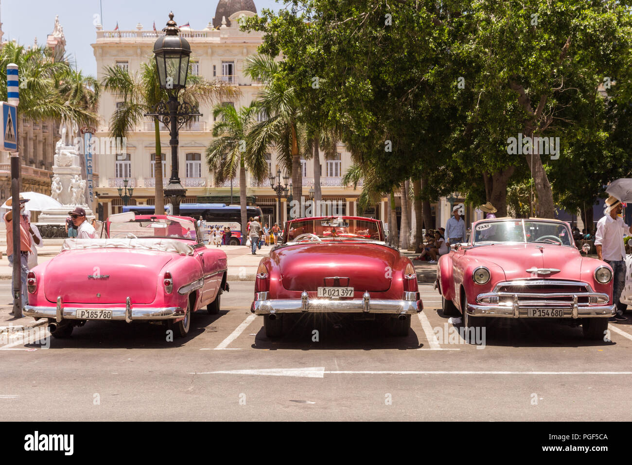 Classic American cars, lined up 1950s vintage automobiles used as taxis, Old Havana, Cuba Stock Photo