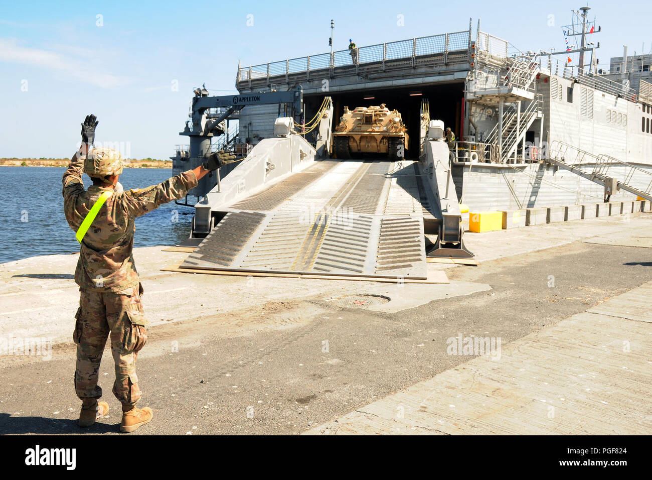 Soldiers assigned to Bravo Company Team, 2nd Battalion, 5th Cavalry Regiment, 1st Armored Brigade Combat Team, 1st Cavalry Division offload an M88A2 Hercules armored recovery vehicle from the United States Naval Ship Carson City, an expeditionary fast transport, at the Port of Constanta, Romania, Aug. 20, 2018. The Soldiers are redeploying after Noble Partner 2018, a Georgian Armed Forces and U.S. Army Europe cooperatively-led event improving readiness and interoperability of Georgia, U.S. and participating nations. Stock Photo