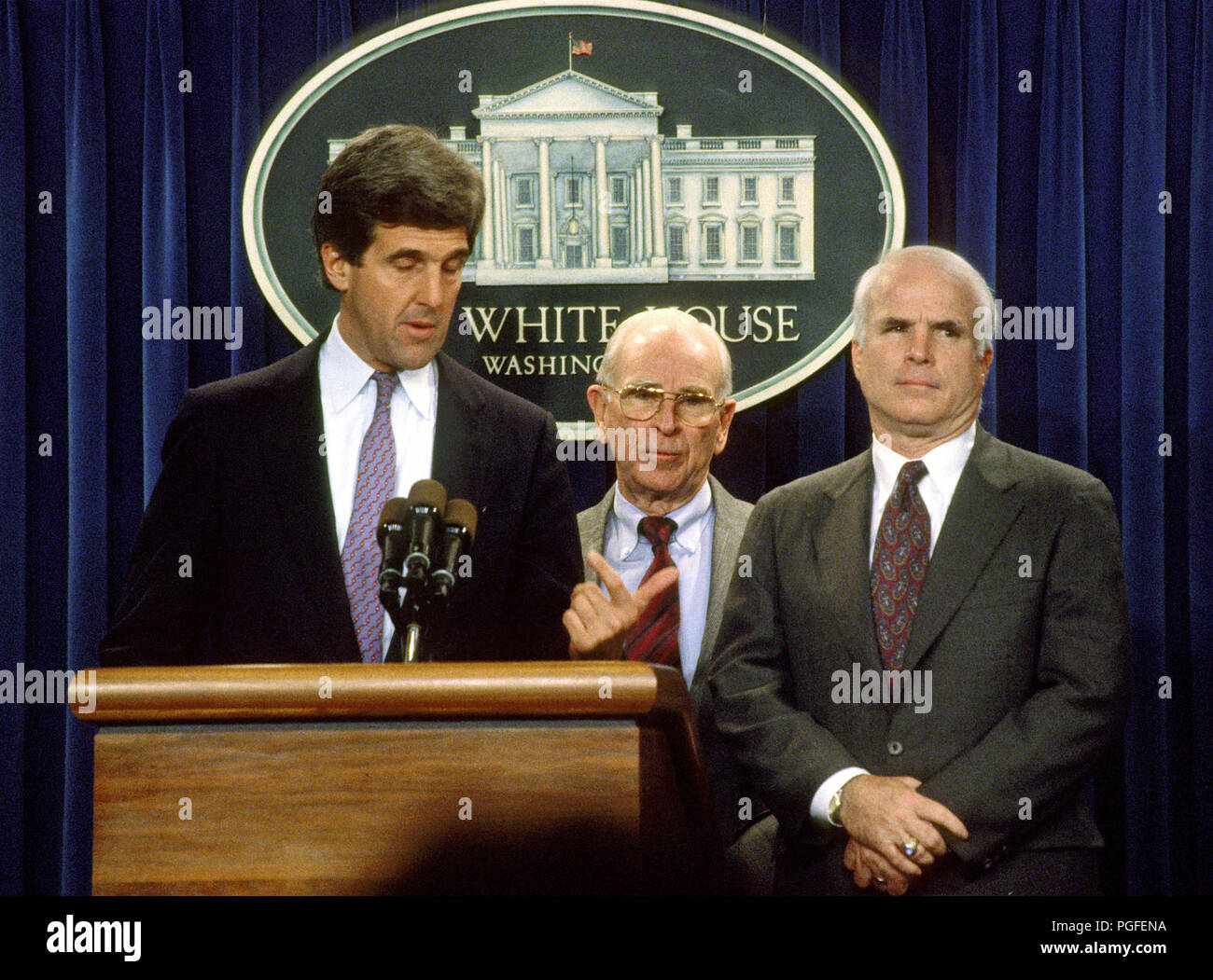 Washington, DC - (FILE) -- United States Senator John F. Kerry (Democrat of Massachusetts), left, retired United States Army General John Vessey, former chairman of the Joint Chiefs of Staff, and Special Emissary to Vietnam for P.O.W./M.I.A. affairs, center, and United States Senator John McCain (Republican of Arizona), right, meet reporters in the White House Press Briefing Room after United States President George H.W. Bush announced the Government of Vietnam had agreed to make available all information including photographs, artifacts, and military documents on United States prisoners of wa - Stock Image