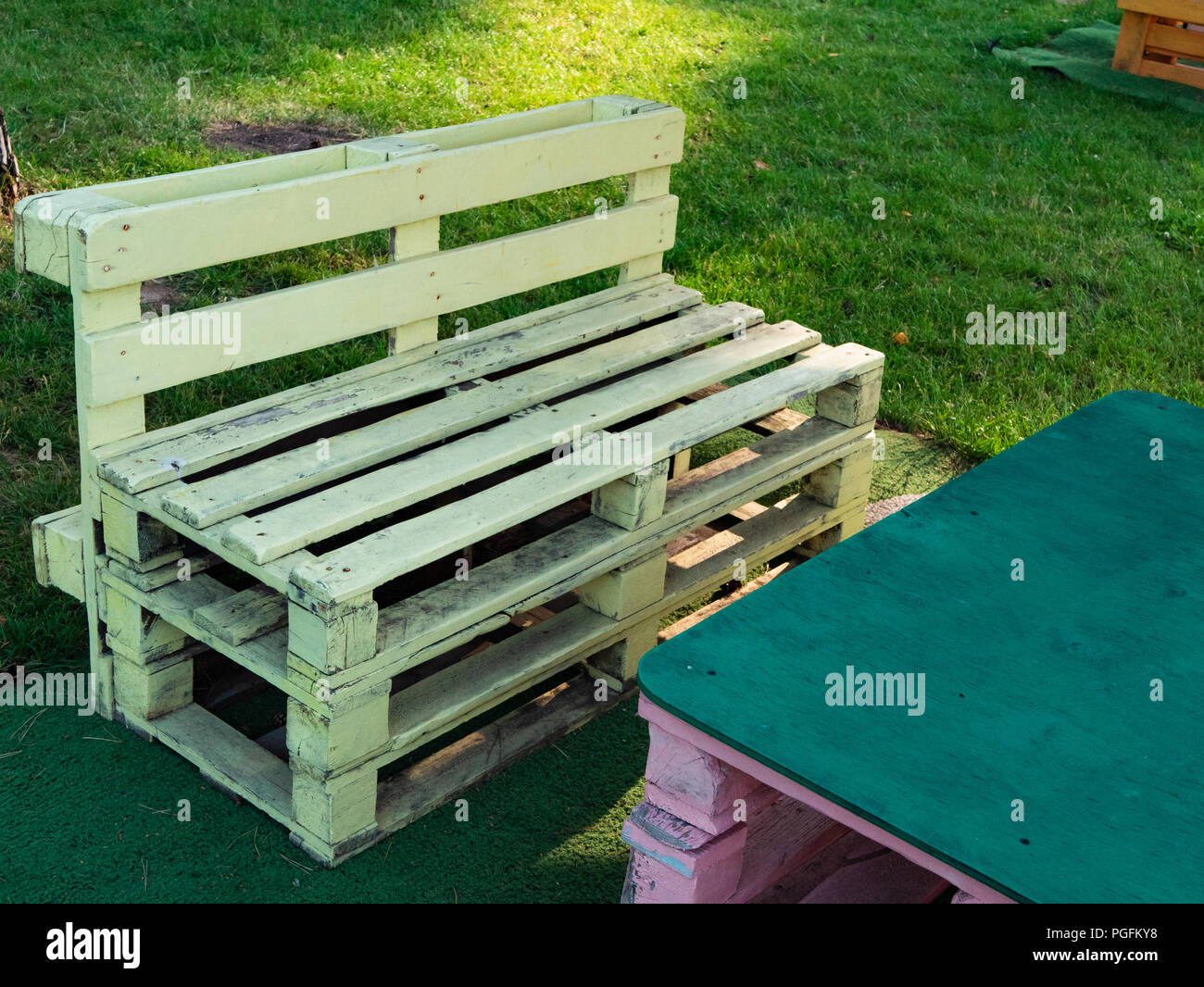 close-up shot of wooden pallet sofa loft style at countryside cafe. lounge chill out relax comfort zone outdoor. summer sunny day Stock Photo