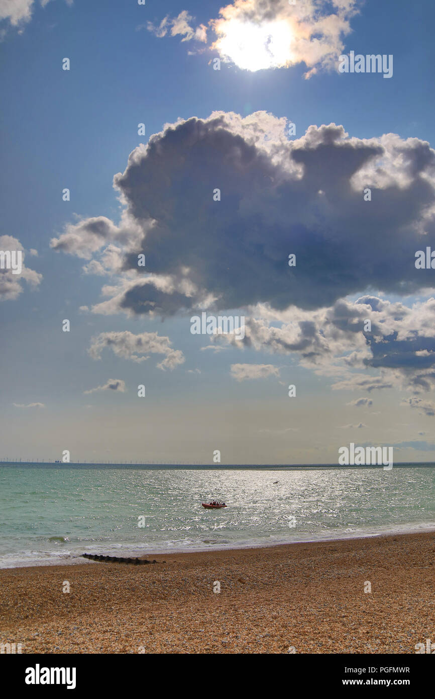 Brighton, UK. 25th Aug, 2018. UK weather: The August bank holiday began with a sunny breezy day but heavy rain is forecast for Bank holiday sunday. Lifeboat patrolling  Brighton beach. Credit: WansfordPhoto/Alamy Live News Credit: WansfordPhoto/Alamy Live News - Stock Image