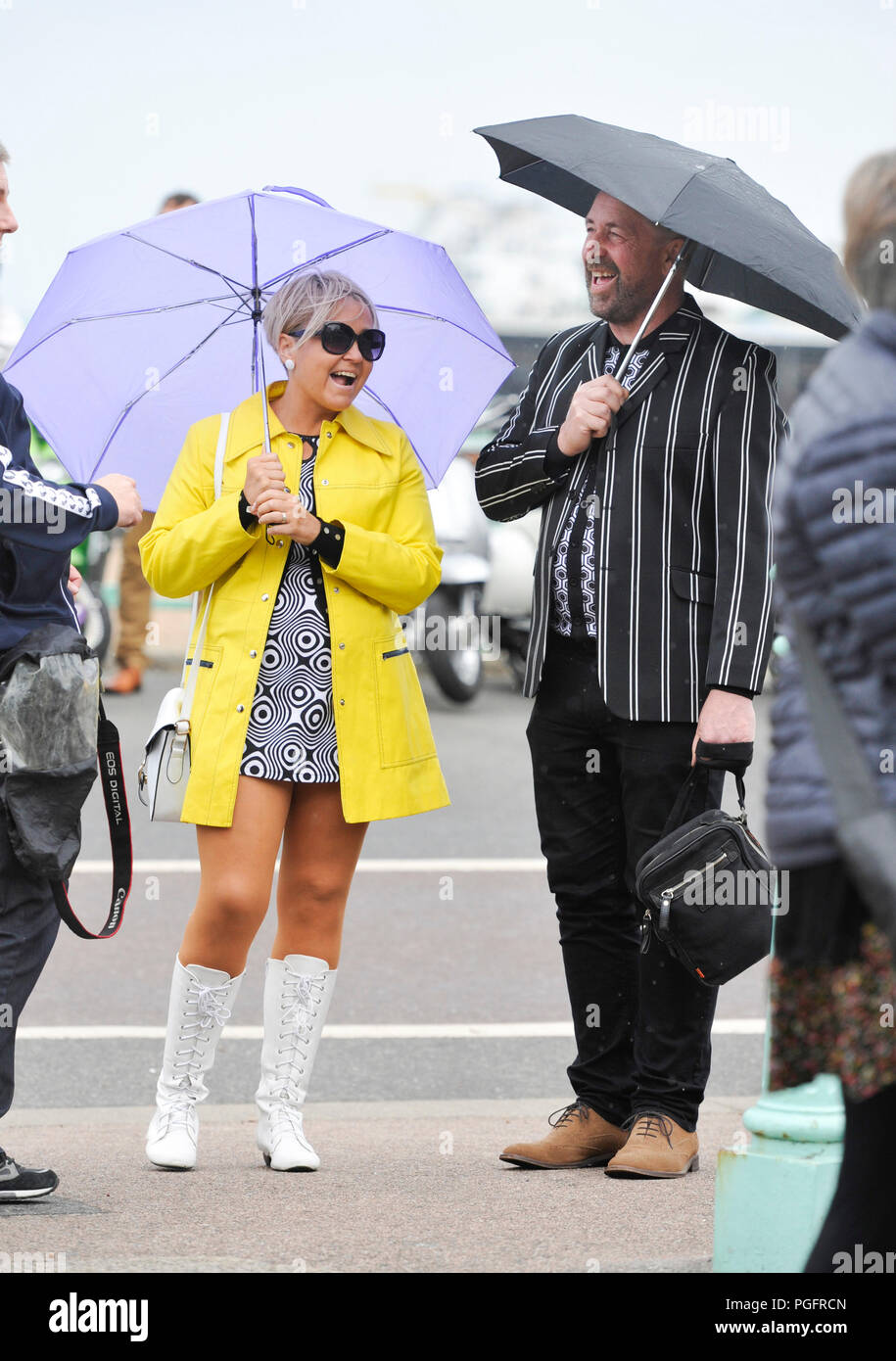 Brighton, UK. 26 August 2018.  Despite the bad weather Mods with their scooters descend on Brighton seafront today as part of their Mod Weekender event . Every August Bank Holiday hundreds of Mods from around the country descend on Brighton for their traditional event which depending on the weather includes a ride out to Beach Head inspired by the film Quadrophenia Photograph taken by Simon Dack Credit: Simon Dack/Alamy Live News Credit: Simon Dack/Alamy Live News - Stock Image