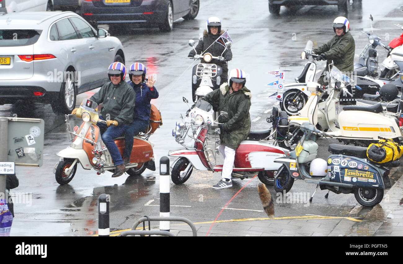 Brighton UK 26th August 2018 - Despite the bad weather Mods with their scooters descend on Brighton seafront today as part of their Mods Weekender event . Every August Bank Holiday hundreds of Mods from around the country descend on Brighton for their traditional event which depending on the weather includes a ride out to Beach Head inspired by the film Quadrophenia Photograph taken by Simon Dack Credit: Simon Dack/Alamy Live News - Stock Image