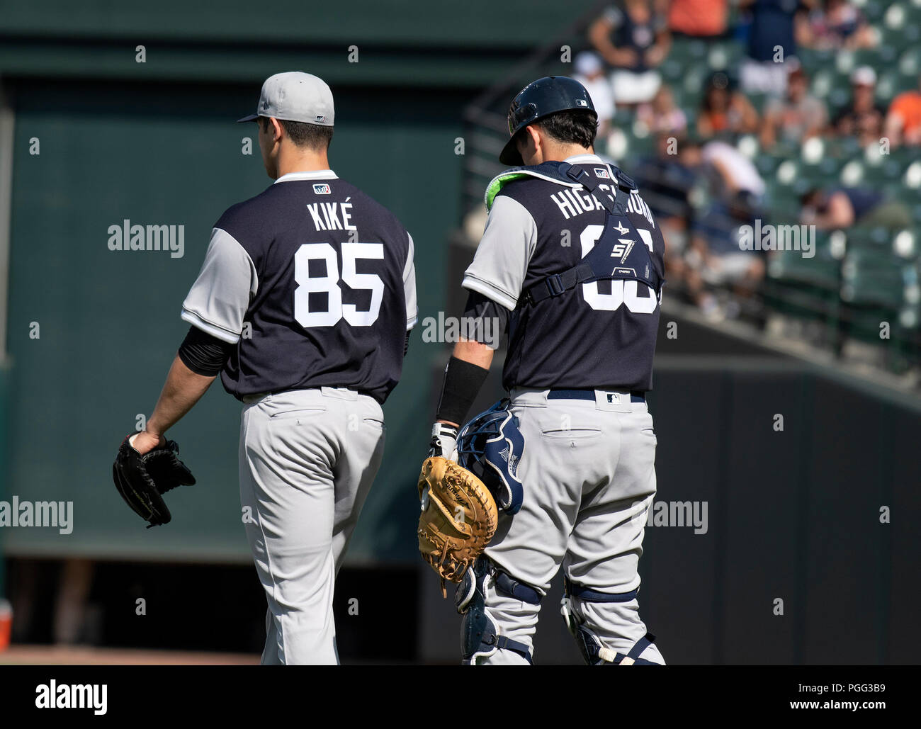 Baltimore, United States Of America. 25th Aug, 2018. New York Yankees relief pitcher Luis Cessa (85), wearing his Player's Weekend jersey and catcher Kyle Higashioka (66) walk to congratulate their teammates after their victory over the Baltimore Orioles at Oriole Park at Camden Yards in Baltimore, MD on Saturday, August 25, 2018. This is the make-up game that was postponed from June 3. The final score was 10 - 3. Credit: Ron Sachs/CNP (RESTRICTION: NO New York or New Jersey Newspapers or newspapers within a 75 mile radius of New York City) | usage worldwide Credit: dpa/Alamy Live News - Stock Image