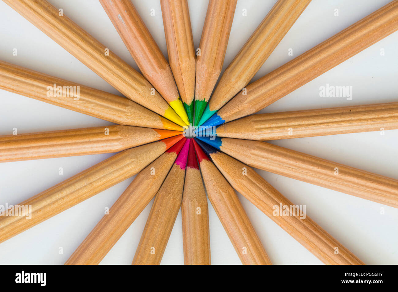 Color pencils ordered on white cardboard - Stock Image