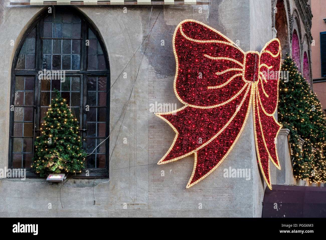 Hostaria dell'Orso at Christmas time with traditional decorations and lights. Big red bow. Ancient 14th century building facade. Rome, Italy, Europe. Stock Photo