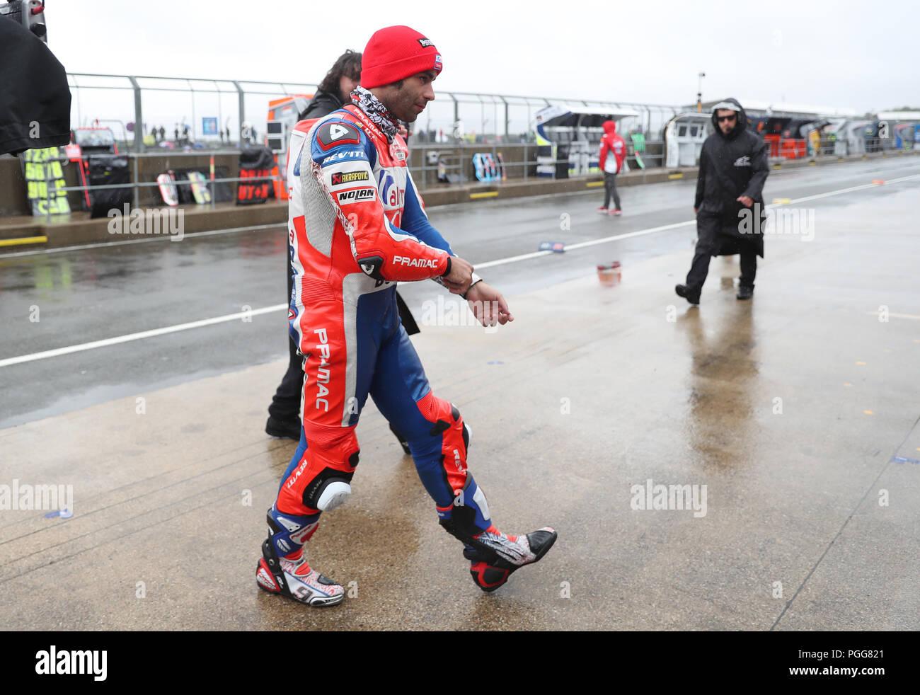 Danilo Petrucci in the pitlane as the GoPro British Grand Prix MotoGP is delayed at Silverstone, Towcester. - Stock Image