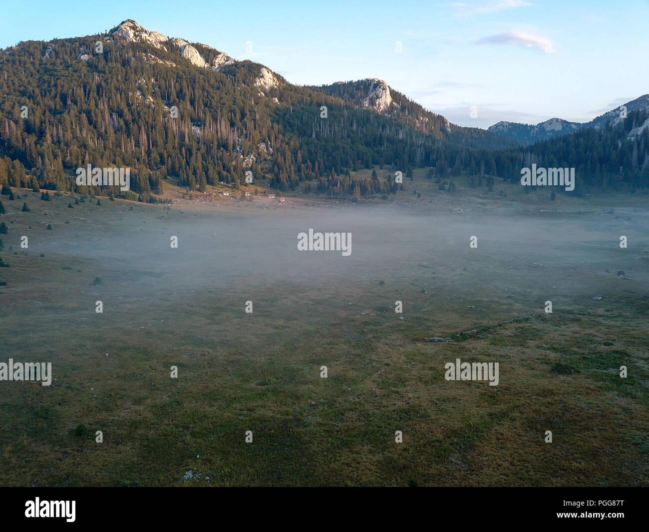 Early morning mist at Veliki Lubenovac, Northern Velebit, Croatia - Stock Image