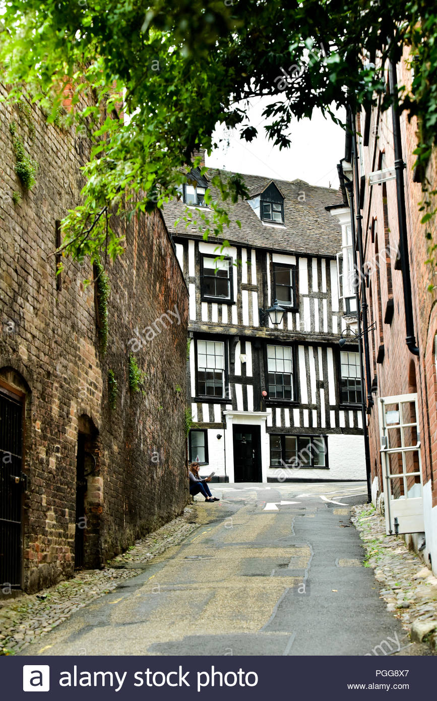 Looking up St Mary's Water Lane towards the 16th century half timbered building, Perches House in Shrewsbury, Shropshire, UK. - Stock Image