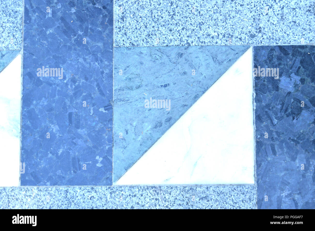 A typical mosaic on the floor of ceramic tiles, squares and diamonds in gray and blue pattern - Stock Image